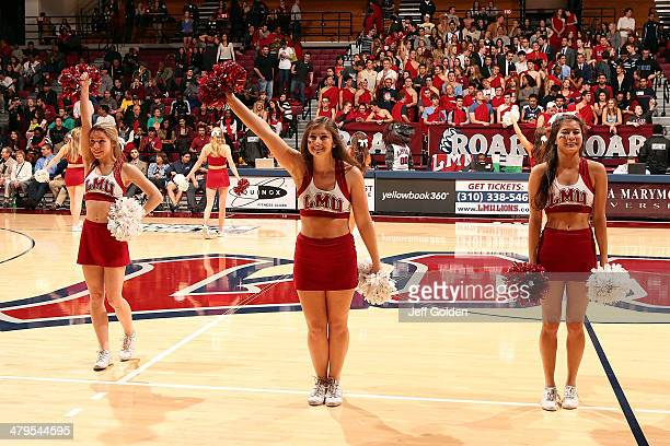 Alexandra Zuccaro Madison Wright and Tessa Soriano of the Loyola Marymount Lions Cheer Team perform during the first half of the game against the...
