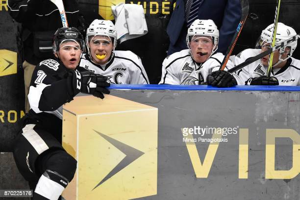 Alexandre Alain of the BlainvilleBoisbriand Armada falls inside the bench of the Gatineau Olympiques while Alex Breton and Will Thompson look on...