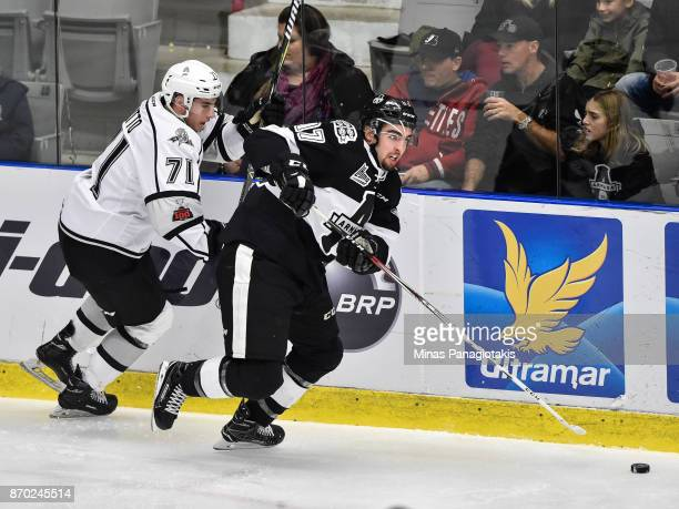 Alexandre Alain of the BlainvilleBoisbriand Armada skates the puck against Samuel Hatto of the Gatineau Olympiques during the QMJHL game at Centre...