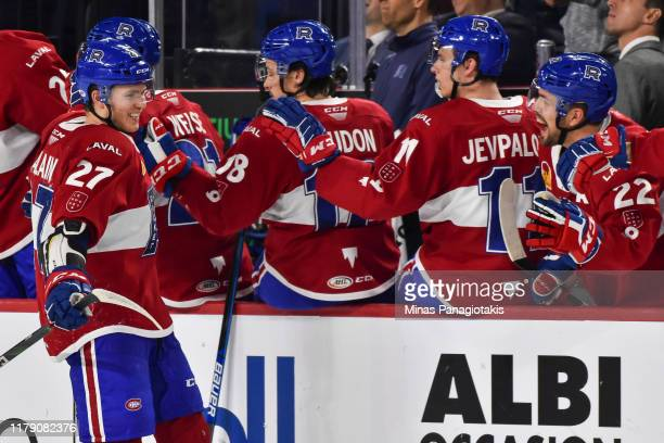 Alexandre Alain of the Laval Rocket celebrates his goal with teammates on the bench against the Hartford Wolfpack during the third period at Place...