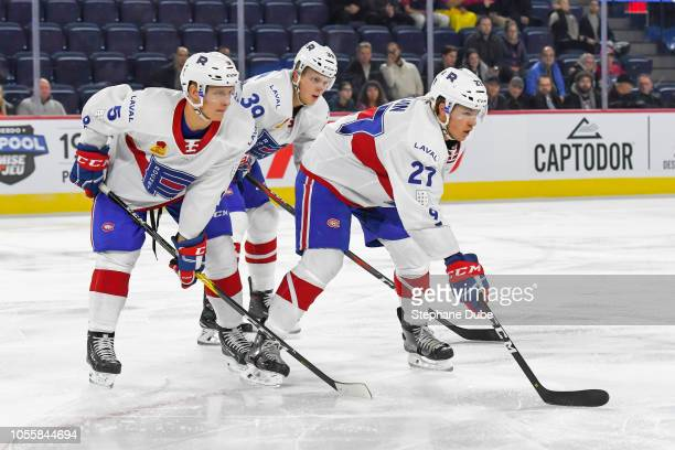 Alexandre Alain of the Laval Rocket David Sklenicka of the Laval Rocket and Hunter Shinkaruk of the Laval Rocket waiting for the puck to drop against...