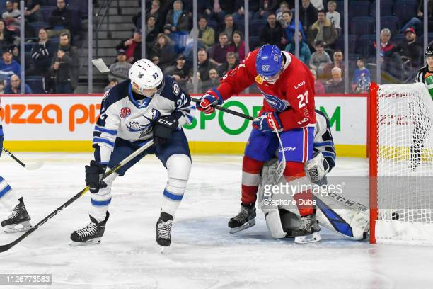 Alexandre Alain of the Laval Rocket scores his goal in front of Eric Comrie of the Manitoba Moose and Kristian Reichel of the Manitoba Moose at Place...