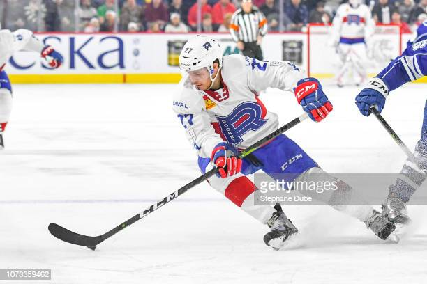 Alexandre Alain of the Laval Rocket taking contro of the puck against the Syracuse Crunch at Place Bell on December 14 2018 in Laval Quebec