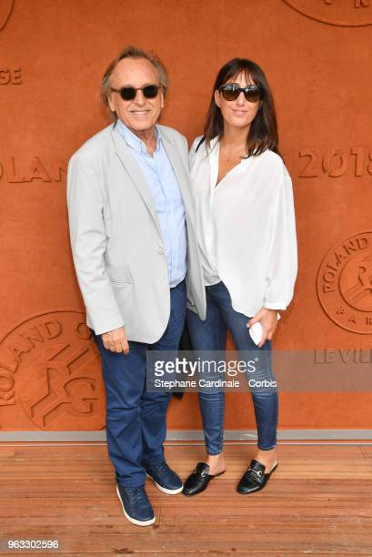 Alexandre Arcady and Sabrina Guigui attend the 2018 French Open Day Two at Roland Garros on May 28 2018 in Paris France