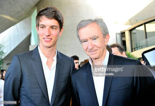 Alexandre Arnault and Chairman and Chief Executive Officer Bernard Arnault attend the Louis Vuitton Cruise 2016 Resort Collection shown at a private...