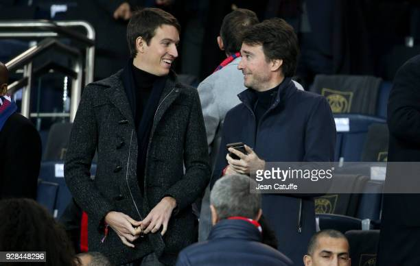 Alexandre Arnault and halfbrother Antoine Arnault attend the UEFA Champions League Round of 16 Second Leg match between Paris SaintGermain and Real...