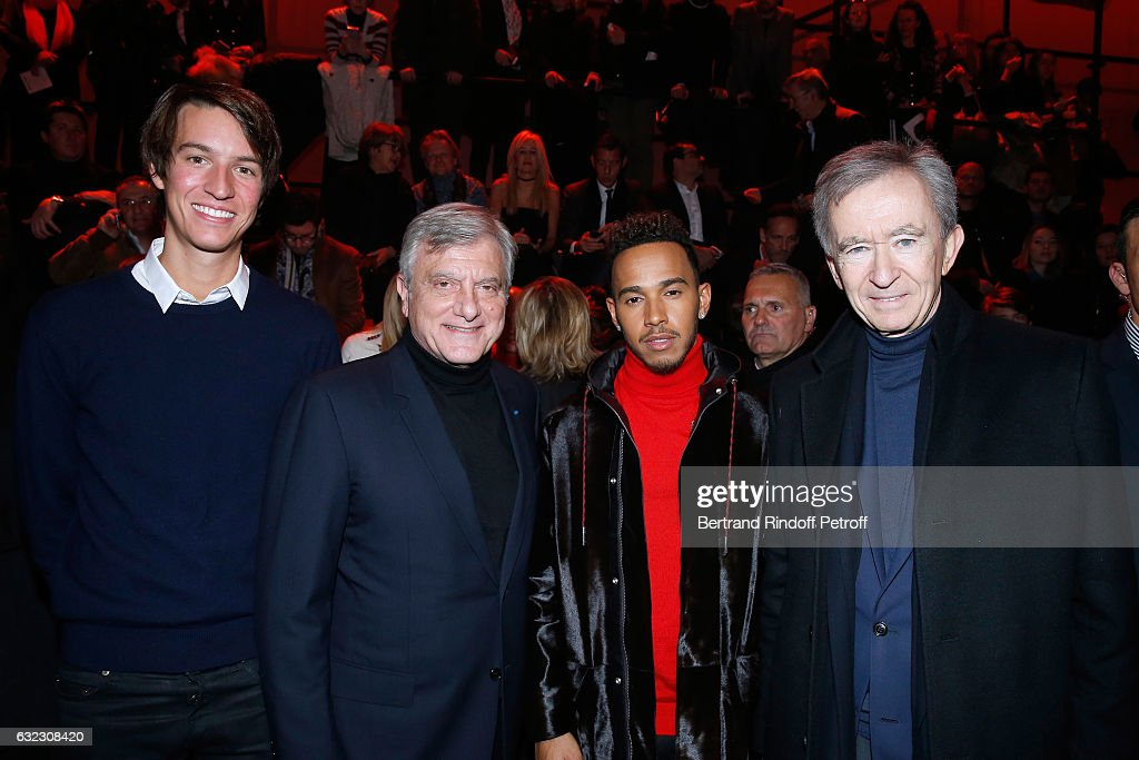 Alexandre Arnault, CEO Dior, Sidney Toledano, Formula One driver, Lewis Hamilton and Owner of LVMH Luxury Group Bernard Arnault the Dior Homme Menswear Fall/Winter 2017-2018 show as part of Paris Fashion Week on January 21, 2017 in Paris, France.