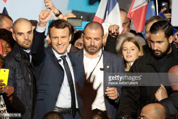 Alexandre Benalla with French presidential election candidate for the En Marche movement Emmanuel Macron gives a speech during a campaign meeting on...