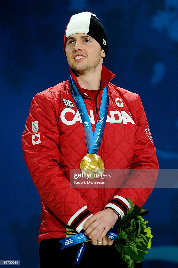 Alexandre Bilodeau of Canada celebrates after receiving the gold medal during the medal ceremony for winning the gold in the Freestyle Skiing Men's Moguls on day 4 of the 2010 Winter Olympics at BC Place on February 15, 2010 in Vancouver, Canada.
