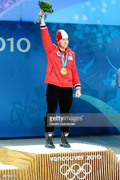 Alexandre Bilodeau of Canada celebrates after receiving the gold medal during the medal ceremony for winning the gold in the Freestyle Skiing Men's...