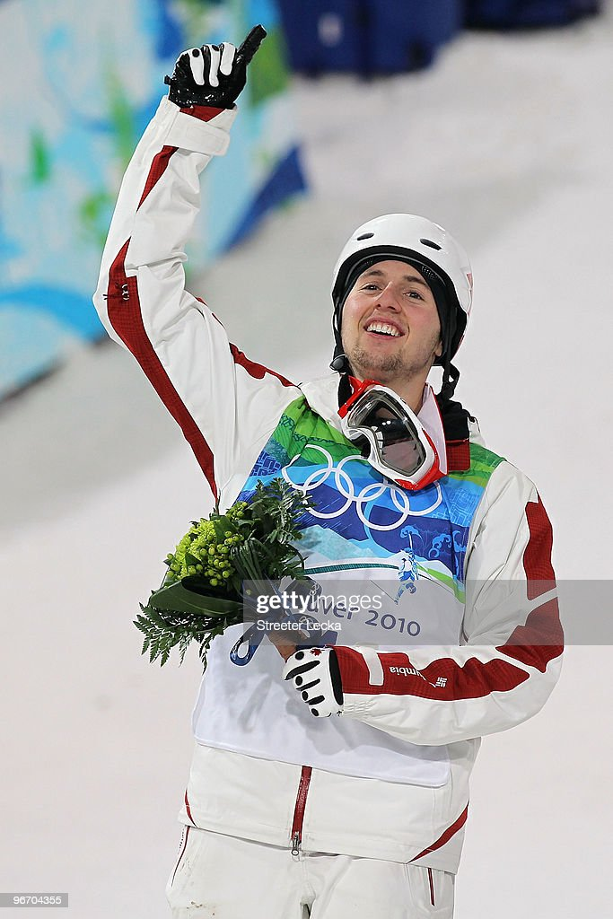 Alexandre Bilodeau of Canada celebrates winning the gold medal during the flower ceremony for the Freestyle Skiing Men's Moguls on day 3 of the 2010 Winter Olympics at Cypress Freestyle Skiing Stadium on February 14, 2010 in Vancouver, Canada. Alexandre Bilodeau of Canada becomes the first Canadian to win a gold medal on home soil at the Winter Olympic Games.