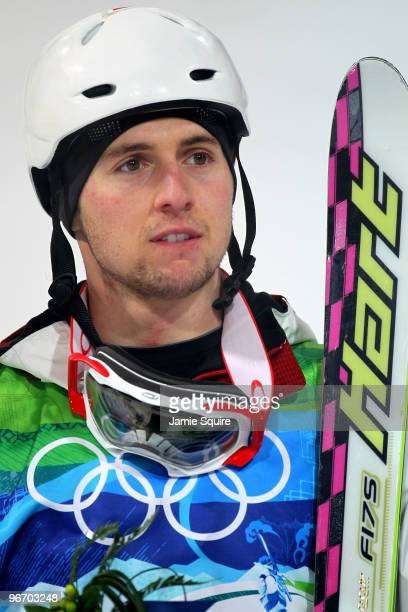 Alexandre Bilodeau of Canada looks on after winning his gold medal during the Freestyle Skiing Men's Moguls on day 3 of the 2010 Winter Olympics at...