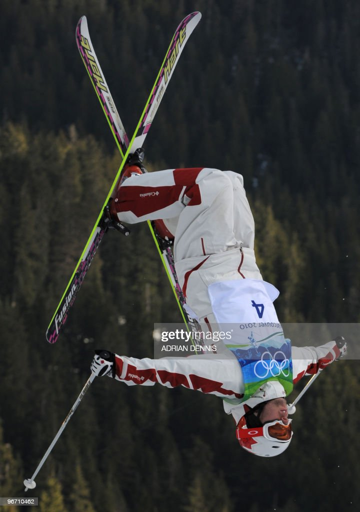 Alexandre Bilodeau of Canada performs an aerial maneuver during the Men's Moguls Freestyle Skiing at Cypress Mountain during the Vancouver Winter Olympics, north of Vancouver on February 14, 2010.