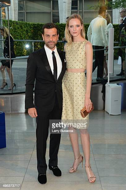 Alexandre Birman and Daria Strokous attend the 2014 CFDA fashion awards at Alice Tully Hall Lincoln Center on June 2 2014 in New York City