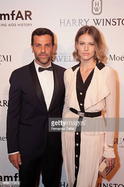 Alexandre Birman and Johanna Stein attend the 5th Annual amfAR Inspiration Gala at the home of Dinho Diniz on April 10 2015 in Sao Paulo Brazil