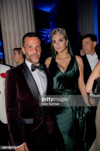 Alexandre Birman and Kate Upton attend the Heavenly Bodies Fashion The Catholic Imagination Costume Institute Gala at The Metropolitan Museum of Art...
