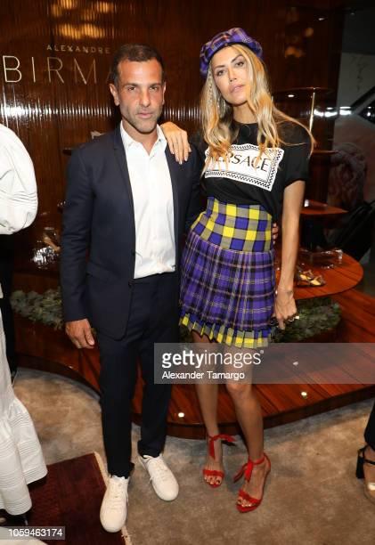 Alexandre Birman and Martha Graeff are seen at the Alexandre Birman Bal Harbor Store Opening Event on November 8 2018 in Miami Florida