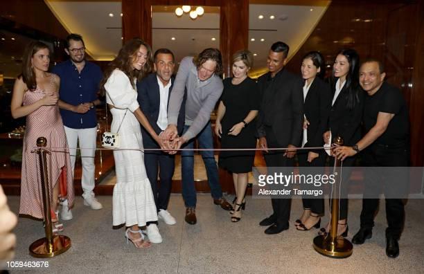 Alexandre Birman and Wayne Kulkin cut the ribbon at the Alexandre Birman Bal Harbor Store Opening Event on November 8 2018 in Miami Florida