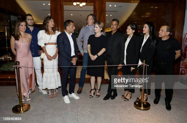 Alexandre Birman and Wayne Kulkin pose with colleagues at the Alexandre Birman Bal Harbor Store Opening Event on November 8 2018 in Miami Florida