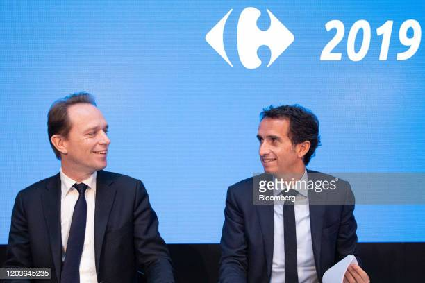 Alexandre Bompard chief executive officer of Carrefour SA right reacts beside Matthieu Malige chief financial officer officer of Carrefour SA during...