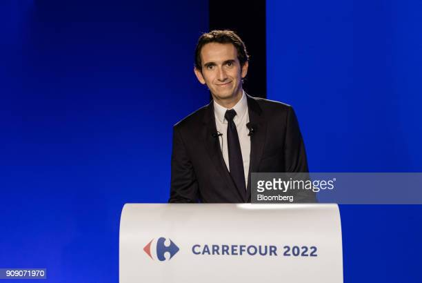 Alexandre Bompard chief executive officer of Carrefour SA stands at a podium during a news conference in Paris France on Tuesday Jan 23 2018...