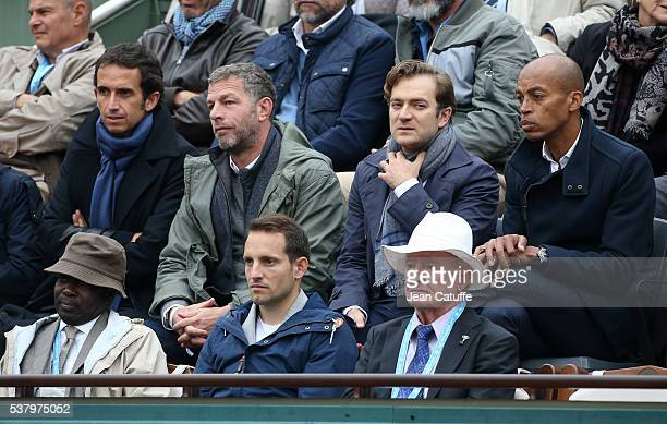 Alexandre Bompard Renaud Capucon Stephane Diagana above them Renaud Lavillenie Rod Laver attend day 13 of the 2016 French Open held at RolandGarros...