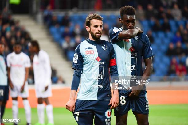 Alexandre Bonnet of Le Havre and Alimami Gory of Le Havre form a defensive wall during the Ligue 2 match between Le Havre AC and Racing Club de Lens...