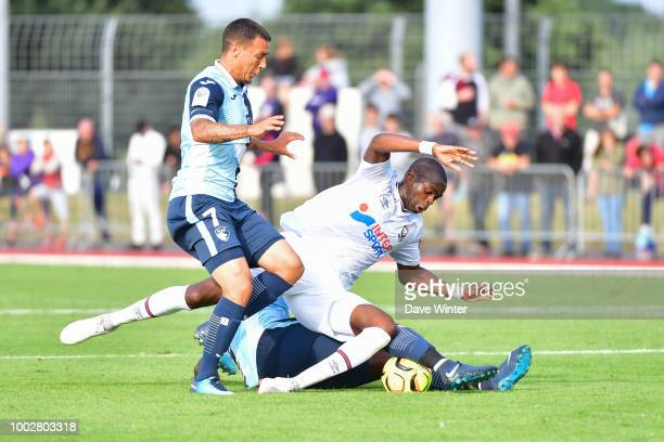 Alexandre Bonnet of Le Havre Prince Oniangue of Caen and Amos Youga of Le Havre during the preseason friendly match for the Trophee des Normands...