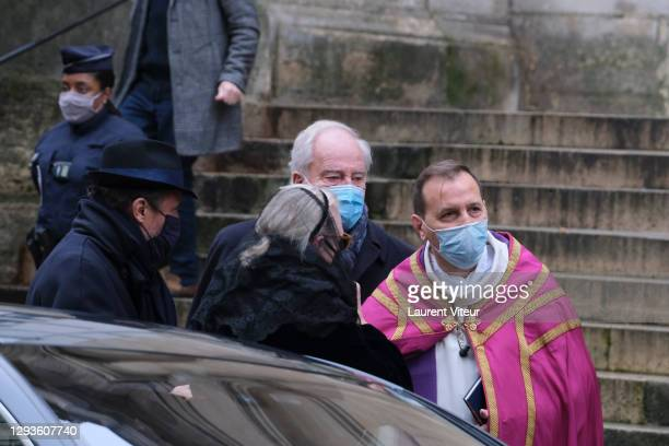 Alexandre Brasseur and his mother Michele Cambon attend actor Claude Brasseur's funeral in Saint Roch Church on December 29, 2020 in Paris, France.