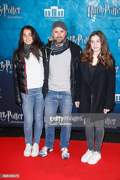 Alexandre Brasseur and his nieces Jeanne and Lea attend 'Harry Potter The Exhibition' at La Cite Du Cinema on April 2 2015 in SaintDenis France