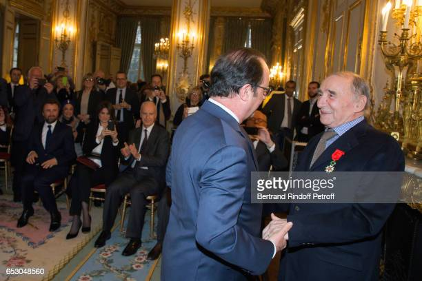 Alexandre Brasseur and his wife Juliette Brasseur attend attend French President Francois Hollande elevates Claude Brasseur to the rank of Officier...
