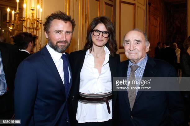 Alexandre Brasseur his wife Juliette Brasseur and his father Claude Brasseur attend Claude Brasseur is elevated to the rank of Officier de la Legion...