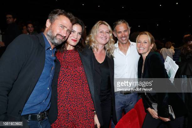 Alexandre Brasseur his wife Juliette Paul Belmondo his wife Luana and Estelle Lefebure attend 'Le Banquet' Theater play at Theatre du RondPoint on...