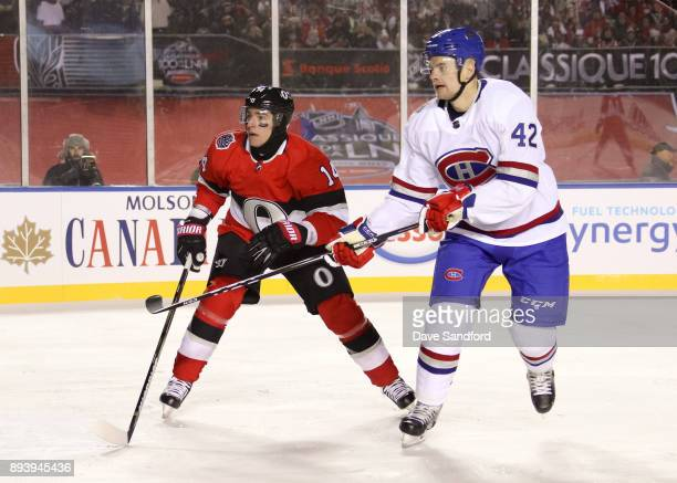 Alexandre Burrows of the Ottawa Senators battles for position with Byron Froese of the Montreal Canadiens during the 2017 Scotiabank NHL100 Classic...
