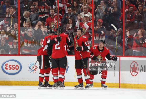 Alexandre Burrows of the Ottawa Senators celebrates his second period goal against the Detroit Red Wings with teammates Derick Brassard Dion Phaneuf...