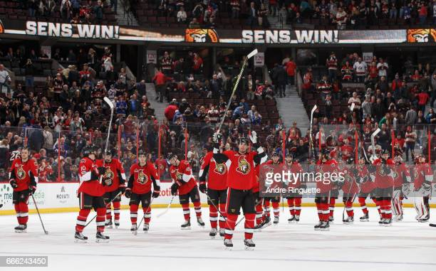 Alexandre Burrows of the Ottawa Senators raises his stick along with his teammates after a win against the New York Rangers at Canadian Tire Centre...