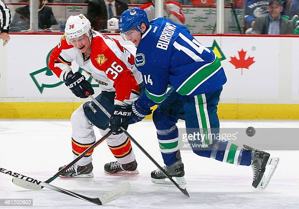 Alexandre Burrows of the Vancouver Canucks checks Jussi Jokinen of the Florida Panthers during their NHL game at Rogers Arena January 8 2015 in...
