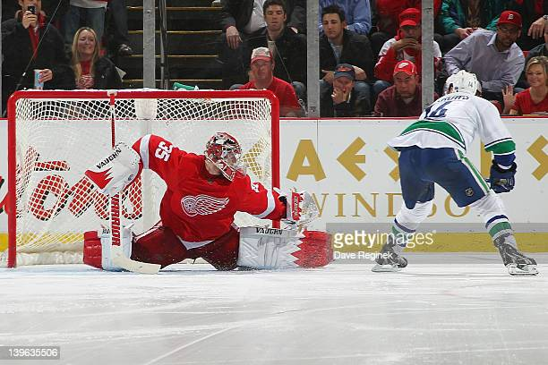Alexandre Burrows of the Vancouver Canucks scores the game winning goal on Jimmy Howard of the Detroit Red Wings in a shootout during an NHL game at...