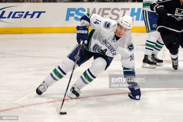 Alexandre Burrows of the Vancouver Canucks skates with the puck against the Los Angeles Kings in Game Three of the Western Conference Quarterfinals...