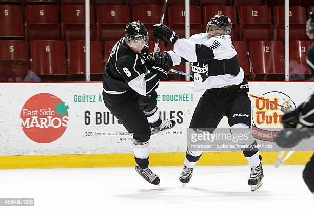 Alexandre Carrier of the Gatineau Olympiques goes airboun as he get checked by Olivier SchinghGomez of the BlainvilleBoisbriand Armada on October 1...