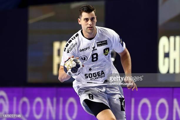 Alexandre Cavalcanti of HBC Nantes passes the ball during the VELUX EHF Champions League FINAL4 semi-final between FC Barcelona v HBC Nantes at...