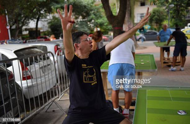 Alexandre Cerqueira Gil a lawyer and football fan gestures during a Button Football match in Rio de Janeiro Brazil on May 19 2018 Every weekend some...