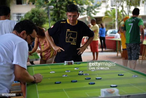 Alexandre Cerqueira Gil a lawyer and football fan watches his opponent during a Button Football match in Rio de Janeiro Brazil on May 19 2018 Every...