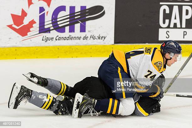 Alexandre Coulombe of the Shawinigan Cataractes holds down Kristian Pospisil of the Blainville-Boisbriand Armada during the QMJHL game at the Centre...