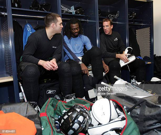 Alexandre Daigle Anson Carter and Glen Murray mprepare for their first skate as members of the Primus Worldstars on December 7 2004 at the Ricoh...