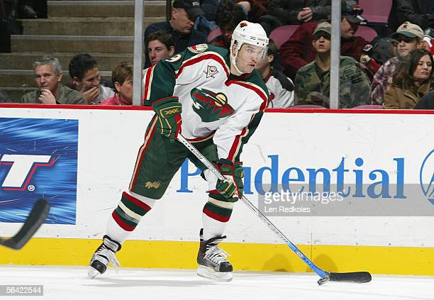 Alexandre Daigle of the Minnesota Wild looks to make a pass play against the New Jersey Devils during their NHL game at Continental Airlines Arena on...