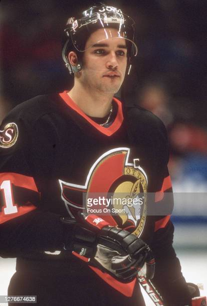 Alexandre Daigle of the Ottawa Senators looks on against the New Jersey Devils during an NHL Hockey game circa 1994 at the Brendan Byrne Arena in...