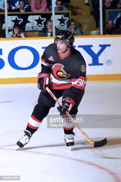 Alexandre Daigle of the Ottawa Senators skates against the Toronto Maple Leafs during NHL game action on December 5 1995 at Maple Leaf Gardens in...