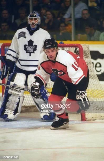 Alexandre Daigle of the Philadelphia Flyers skates against Curtis Joseph of the Toronto Maple Leafs during NHL game action on December 12, 1998 at...
