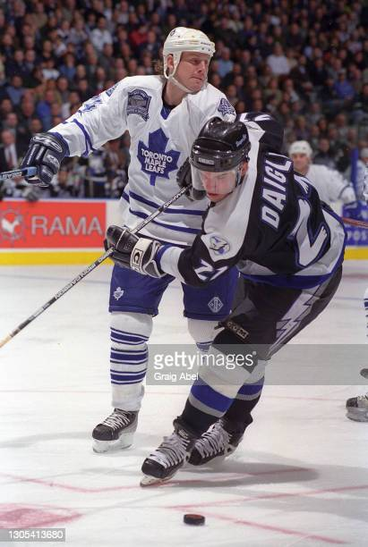 Alexandre Daigle of the Tampa Bay Lightning skates against Bryan Berard of the Tampa Bay Lightning during NHL game action on March 9, 1999 at Air...